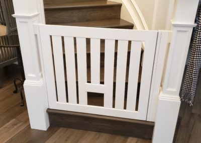 Baby gate with pet opening