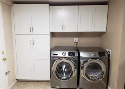 Use cabinets to tidy the laundry room