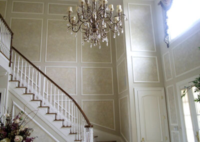 Moldings on wall near staircase